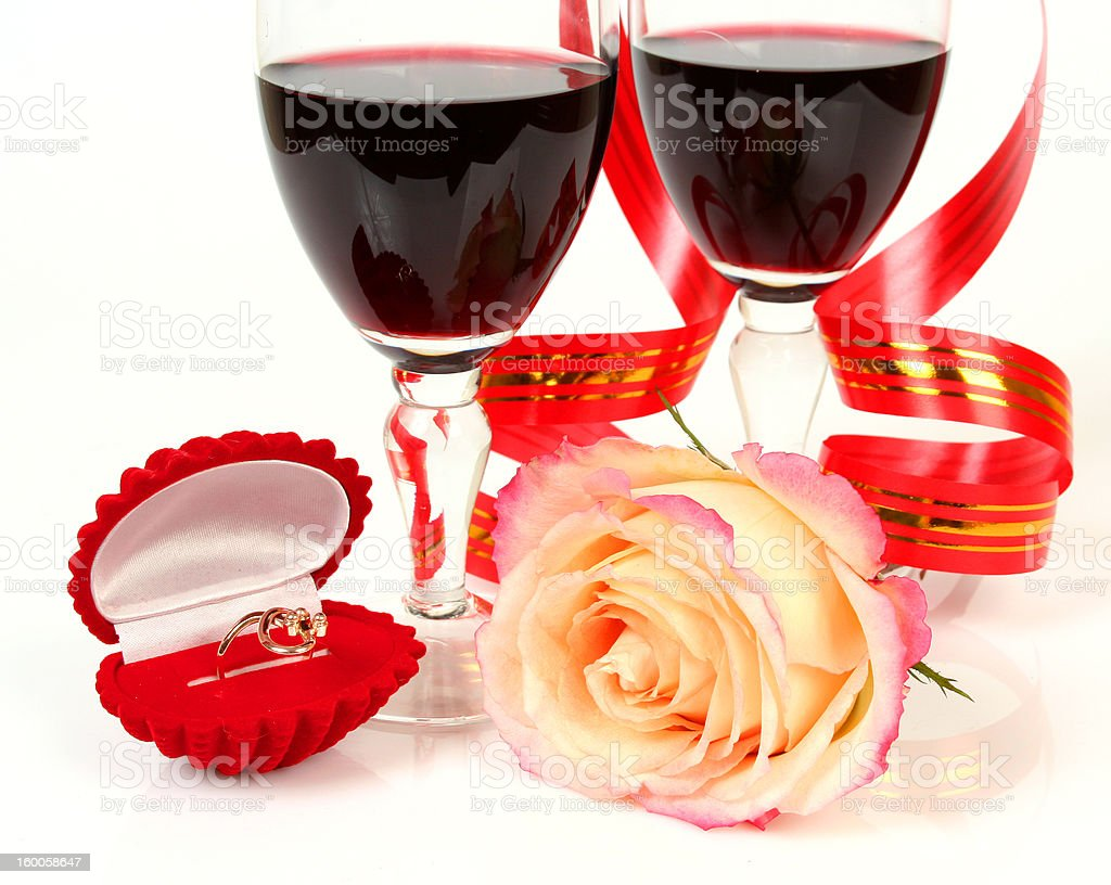 Wine and gold ring stock photo