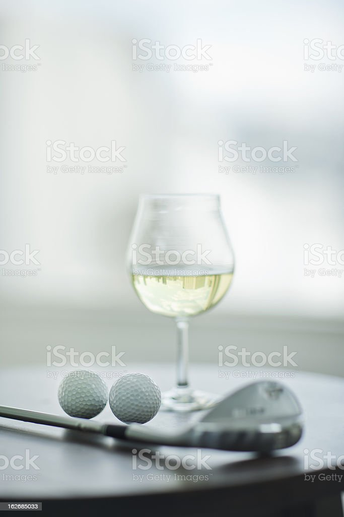 Wine and golf royalty-free stock photo