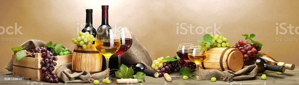 Wine and grapes on beige background stock photo