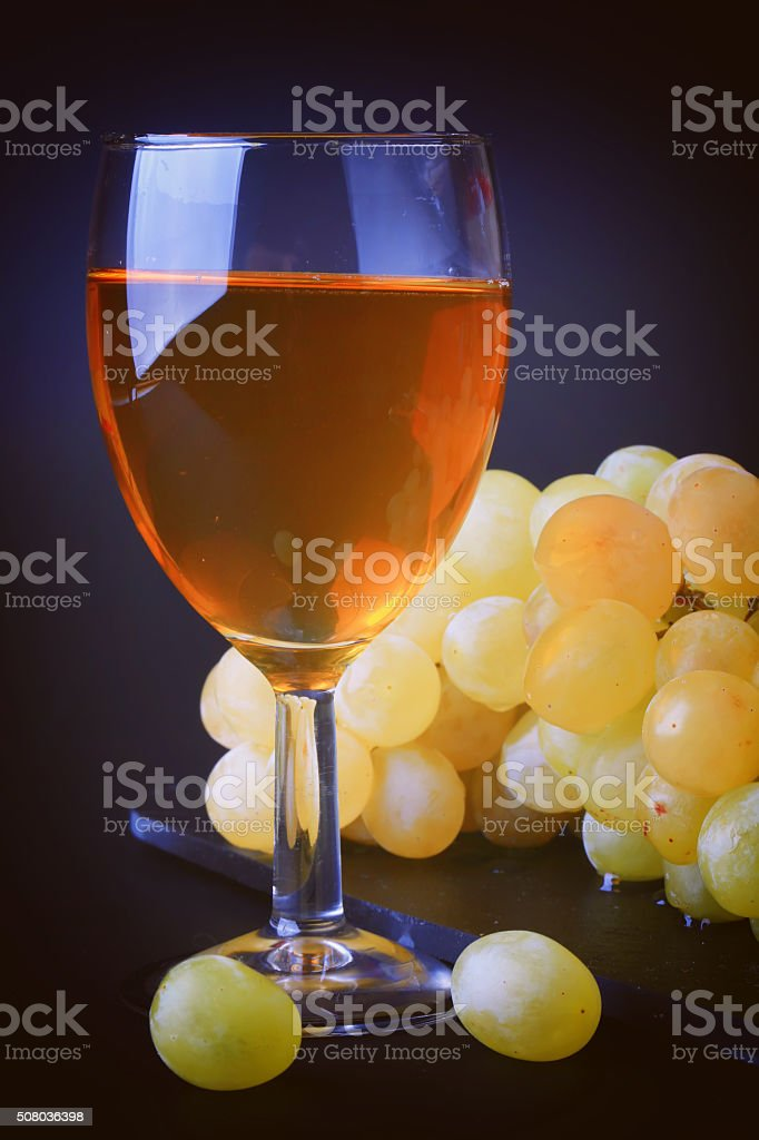 wine and grapes White dry dessert stock photo