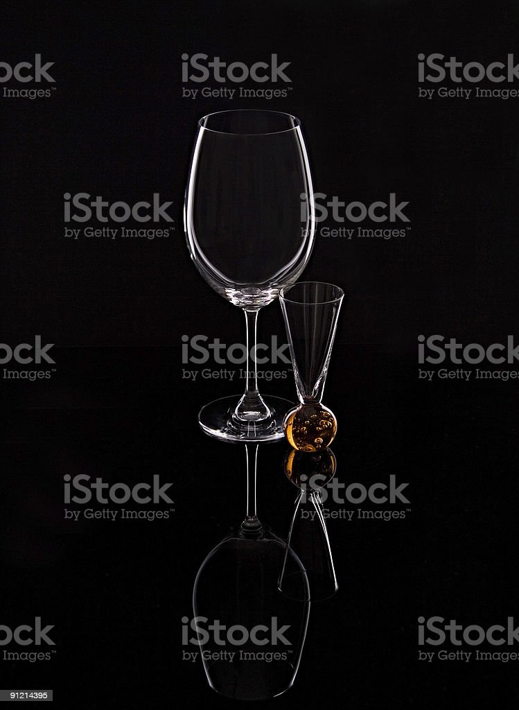 Wine And Liqueur Glass On Black Mirror royalty-free stock photo