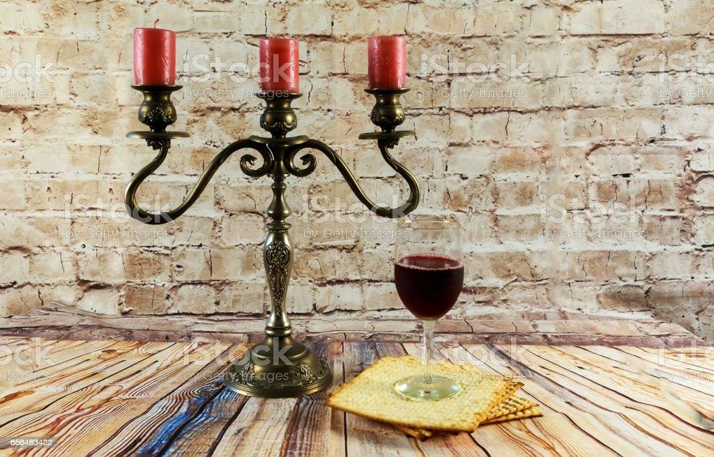 wine and matzoh jewish passover candles jewish bread stock photo