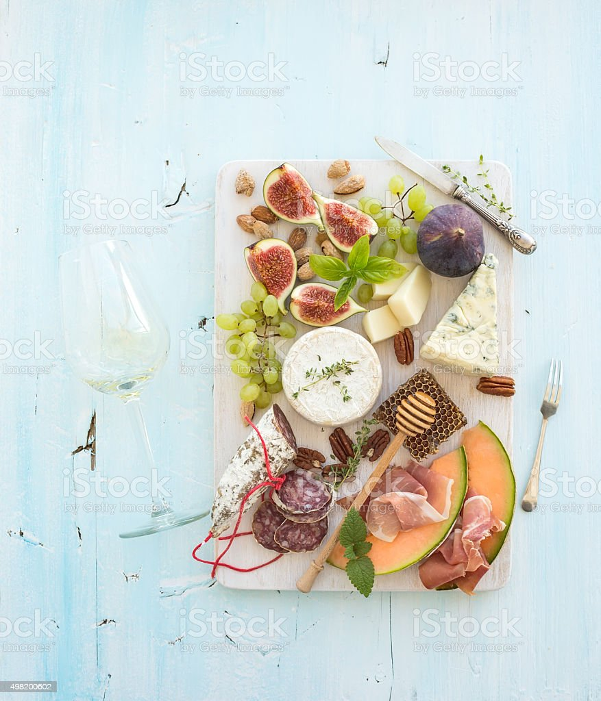 Wine and snack set. Figs, grapes, nuts, cheese variety, meat stock photo