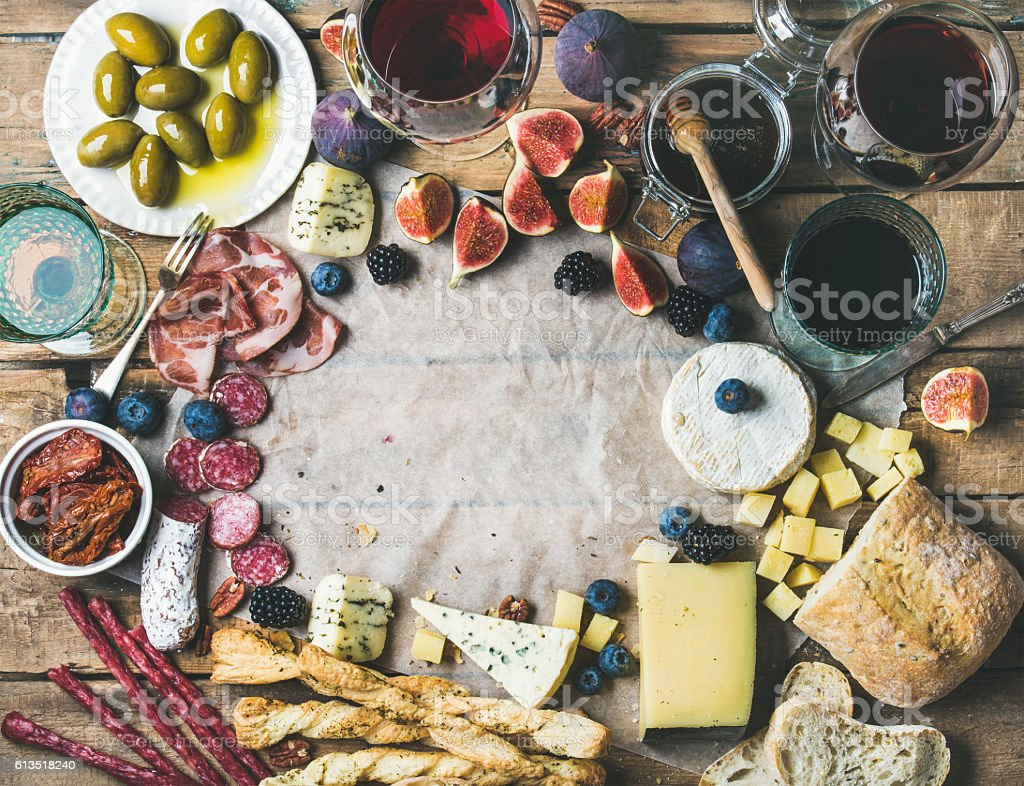 Wine and snack set with wines, meat, bread, olives, fruits stock photo