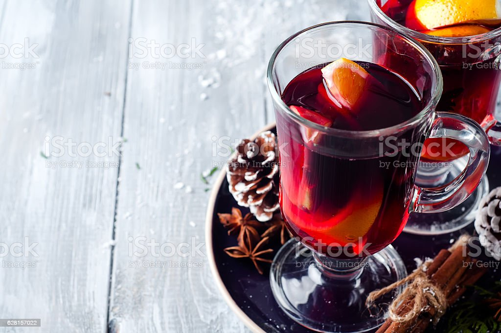 wine and spices on wooden background. stock photo
