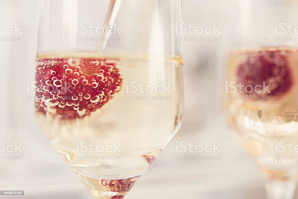 Wine and strawberries stock photo