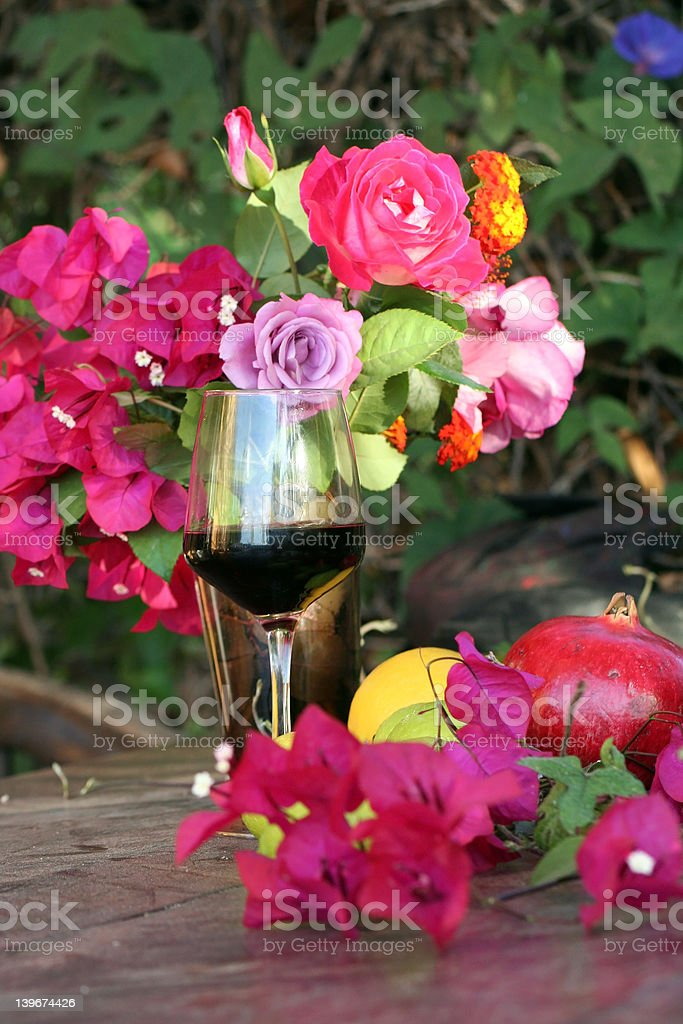 Wine and summer flowers royalty-free stock photo