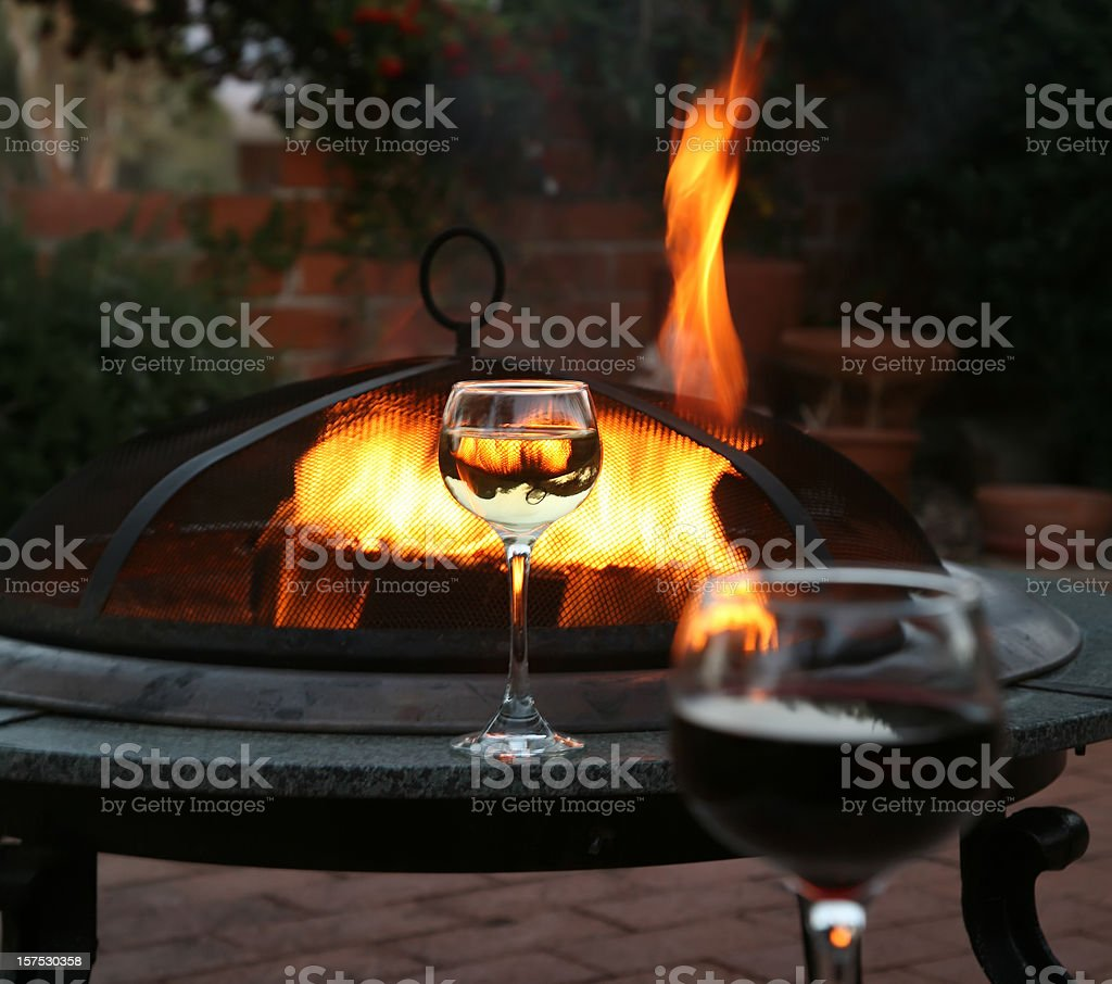 Wine And The Patio Firepit royalty-free stock photo
