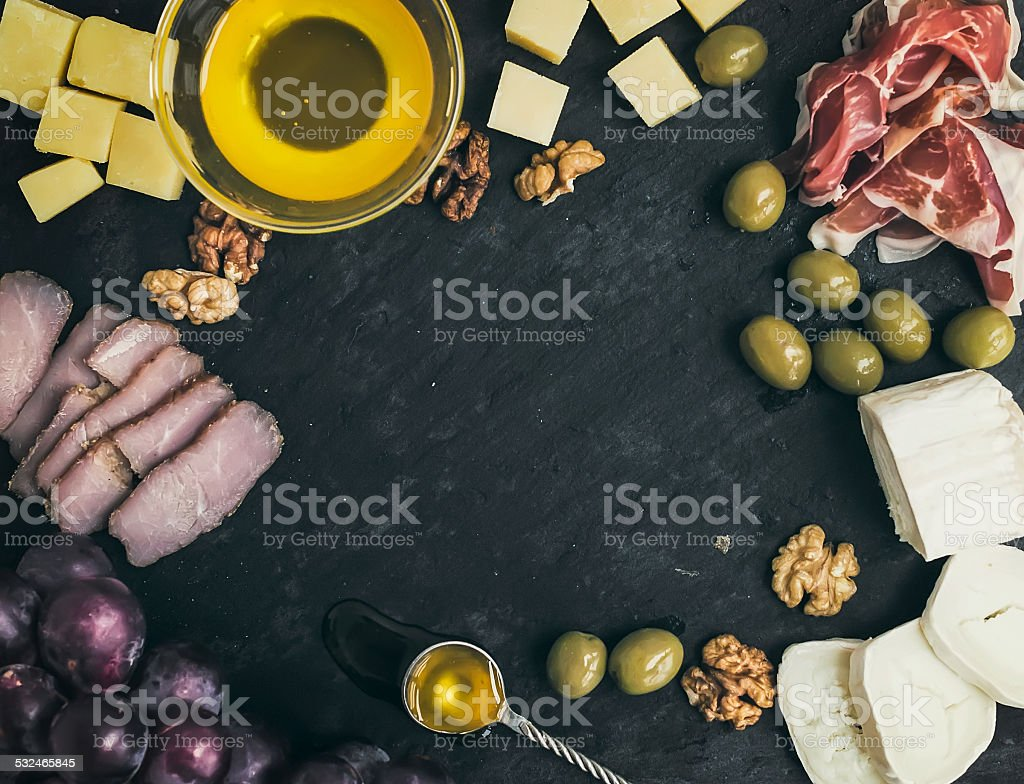 Wine appetizer set: cheese and meat selection with grapes, honey stock photo