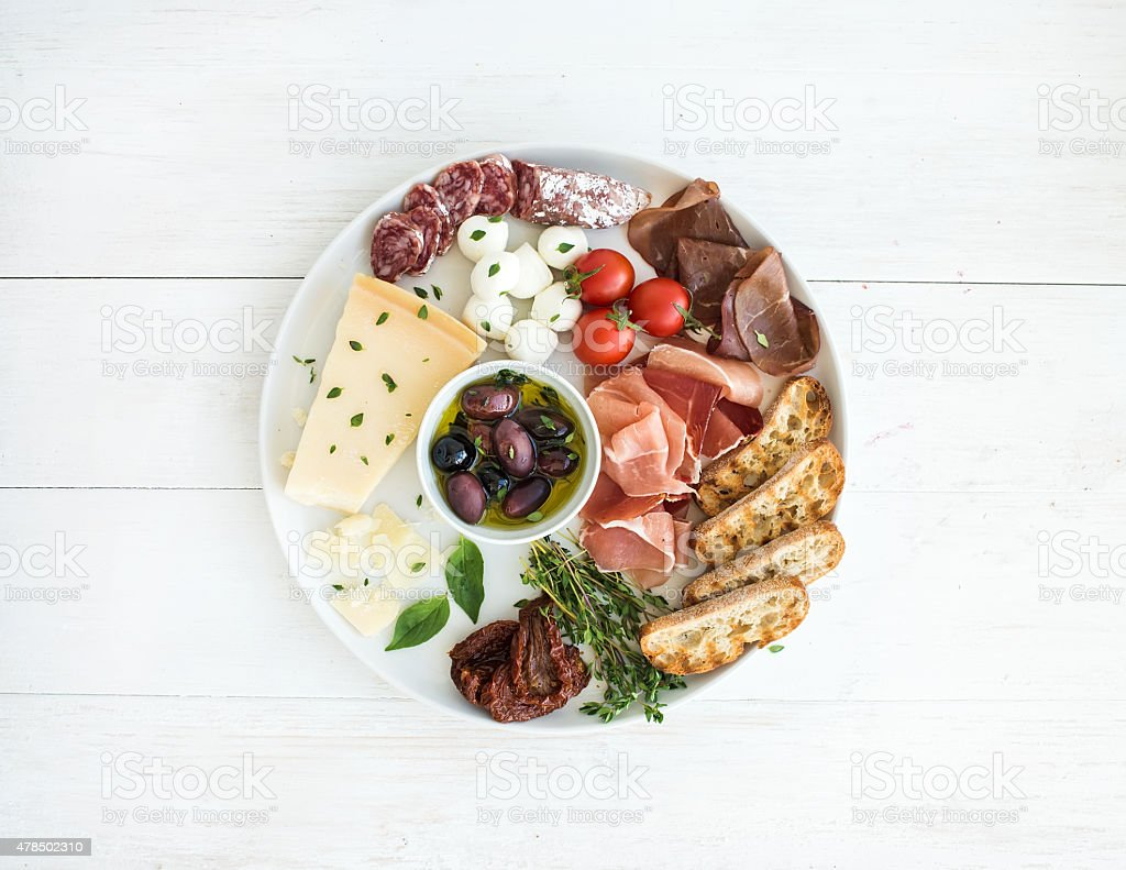 Wine appetizer set. Cherry-tomatoes, parmesan cheese, meat variety,...