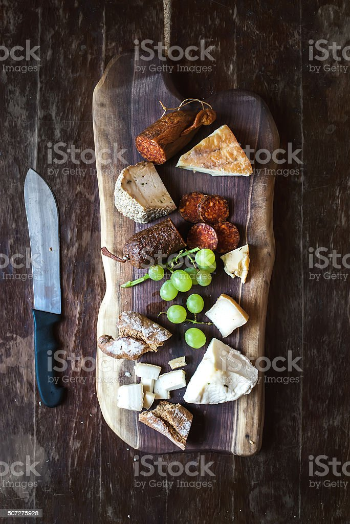 Wine appetizers set: meat and cheese selection, grapes, bread on stock photo