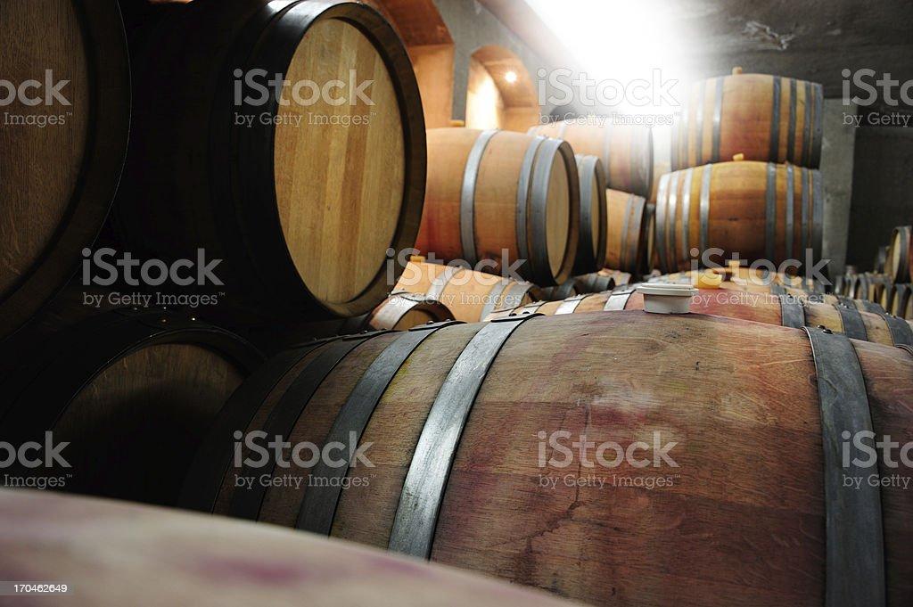 Wine barrells in cellar royalty-free stock photo