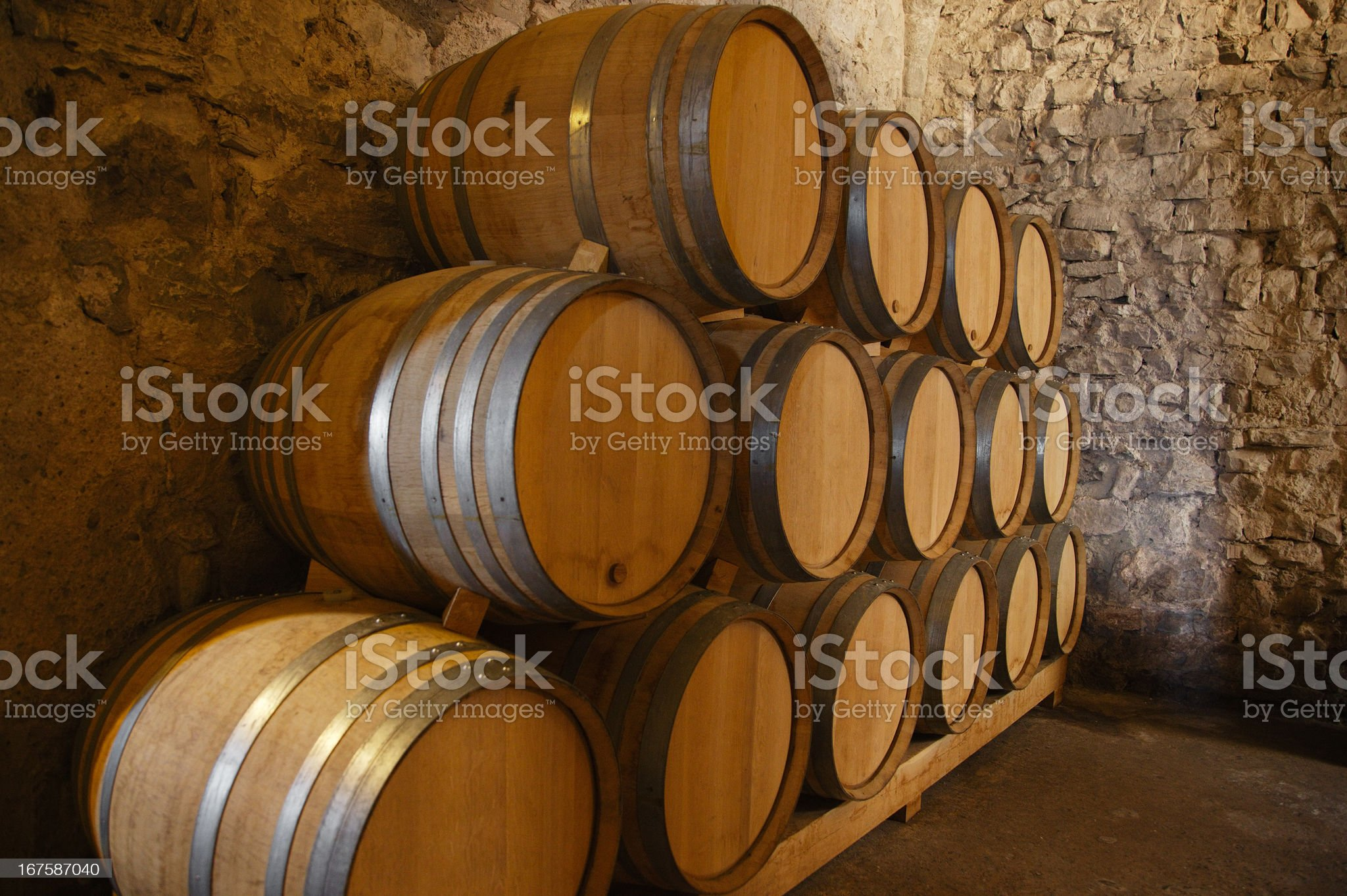 Wine barrels in a old cellar royalty-free stock photo