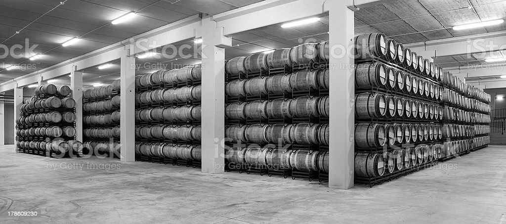 Wine barrels in an aging process royalty-free stock photo