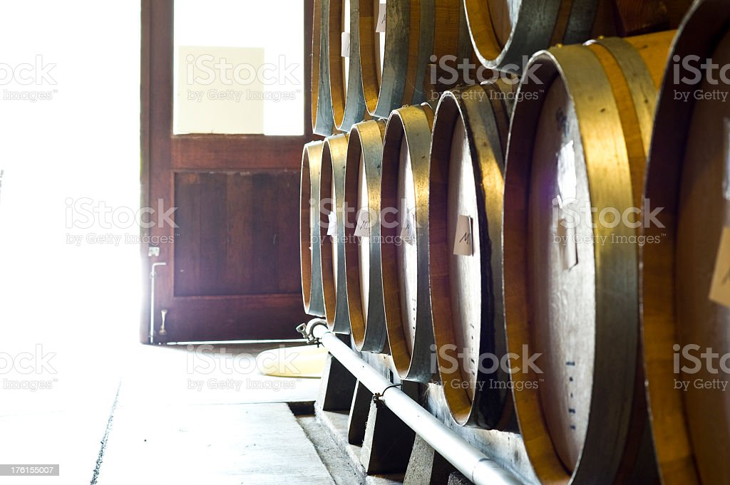 Wine barrels in cave at a Winery royalty-free stock photo