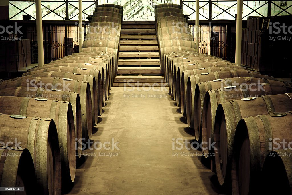 Wine barrels in cellar stock photo