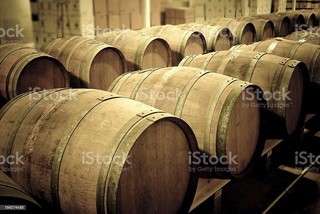 Wine barrels in cellar stock photo