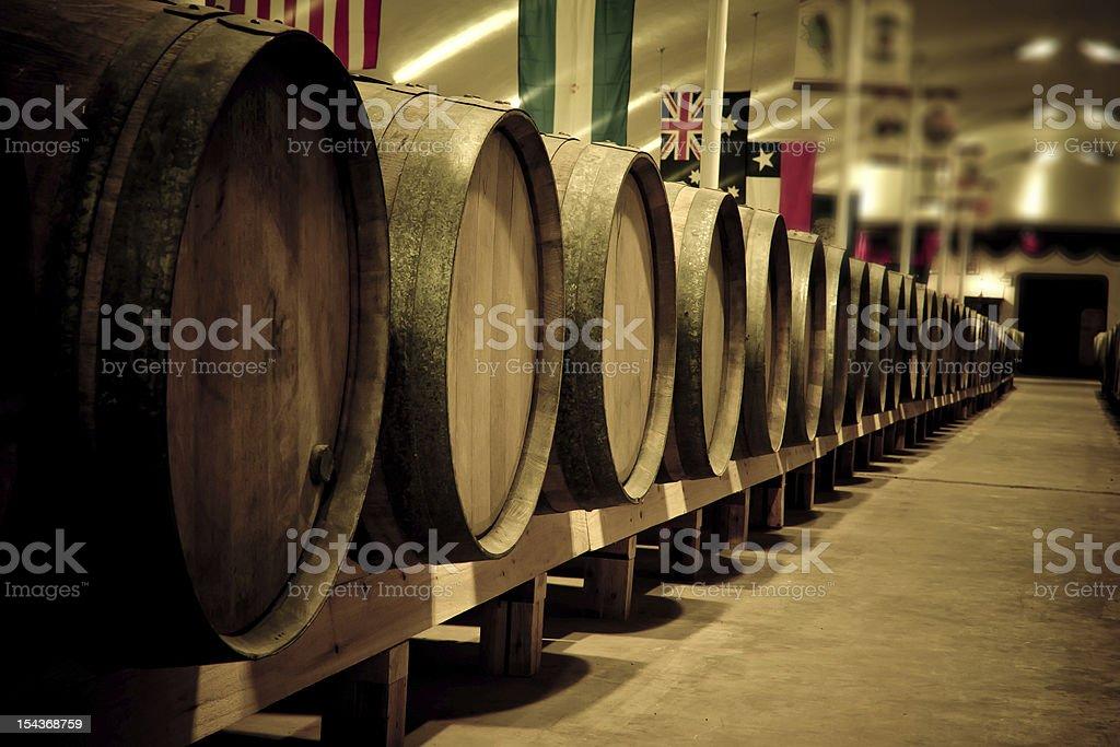 Wine barrels in cellar royalty-free stock photo