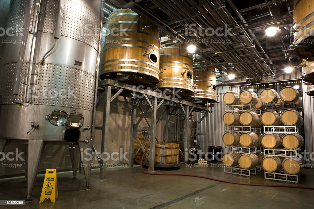 Wine barrels in cellar royalty-free stock photo