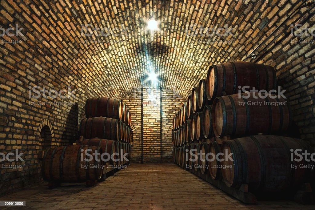 Wine barrels in the old cellar of a winery stock photo