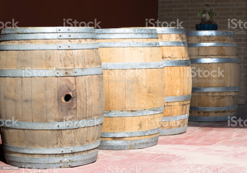 Wine barrels in the vineyard of Piemonte, Italy stock photo