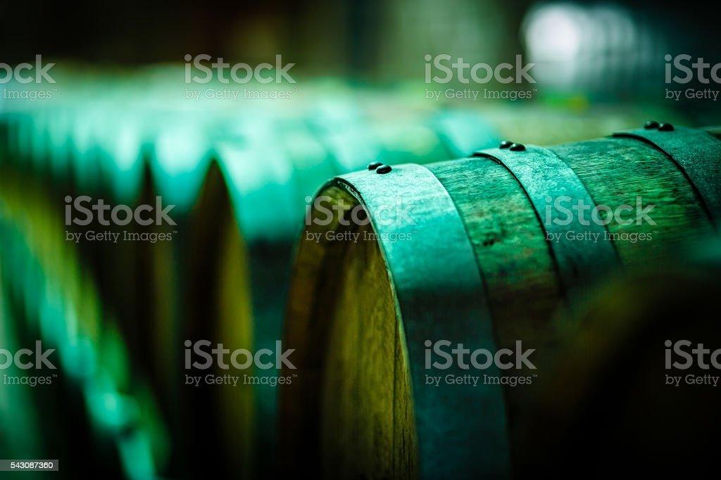 Wine barrels in wine cellar stock photo