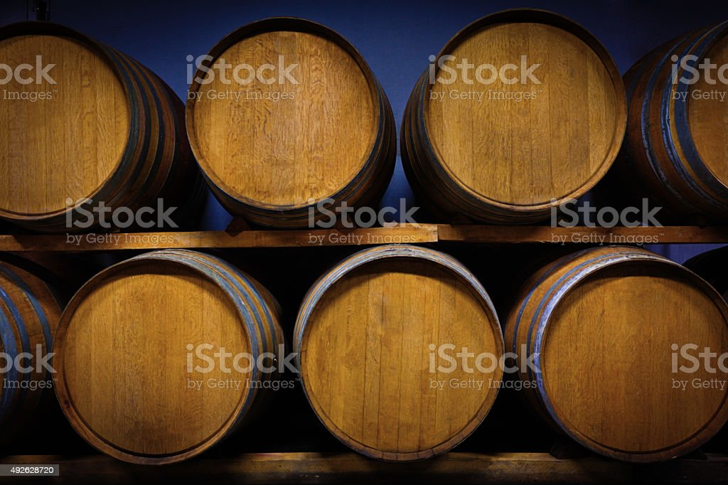Wine Barrels in Winery Cellar in Tuscany Italy stock photo