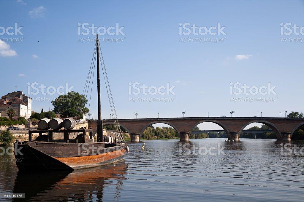 wine barrels on traditional gabarre boat Bergerac Dordogne France stock photo