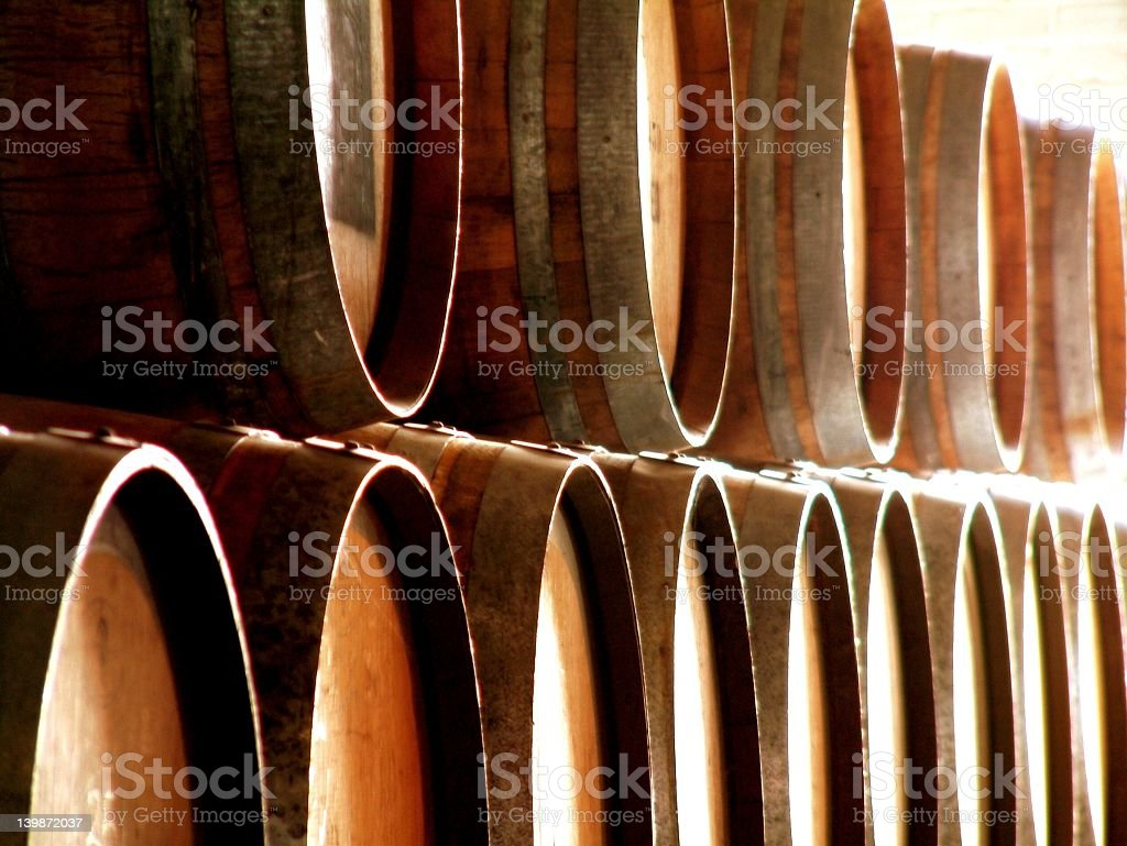 Wine barrels stacked in a warehouse stock photo