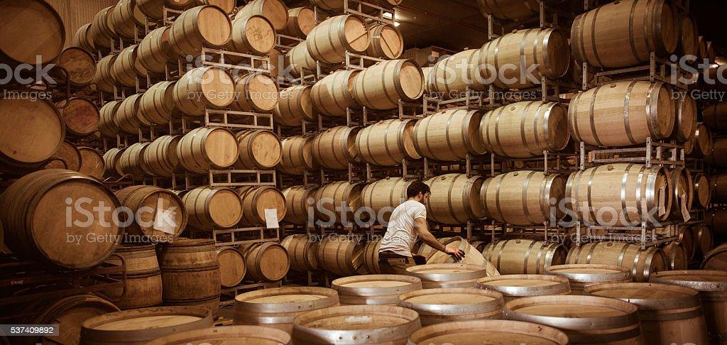 Wine barrels stacked in cellar, Bordeaux Vineyard stock photo