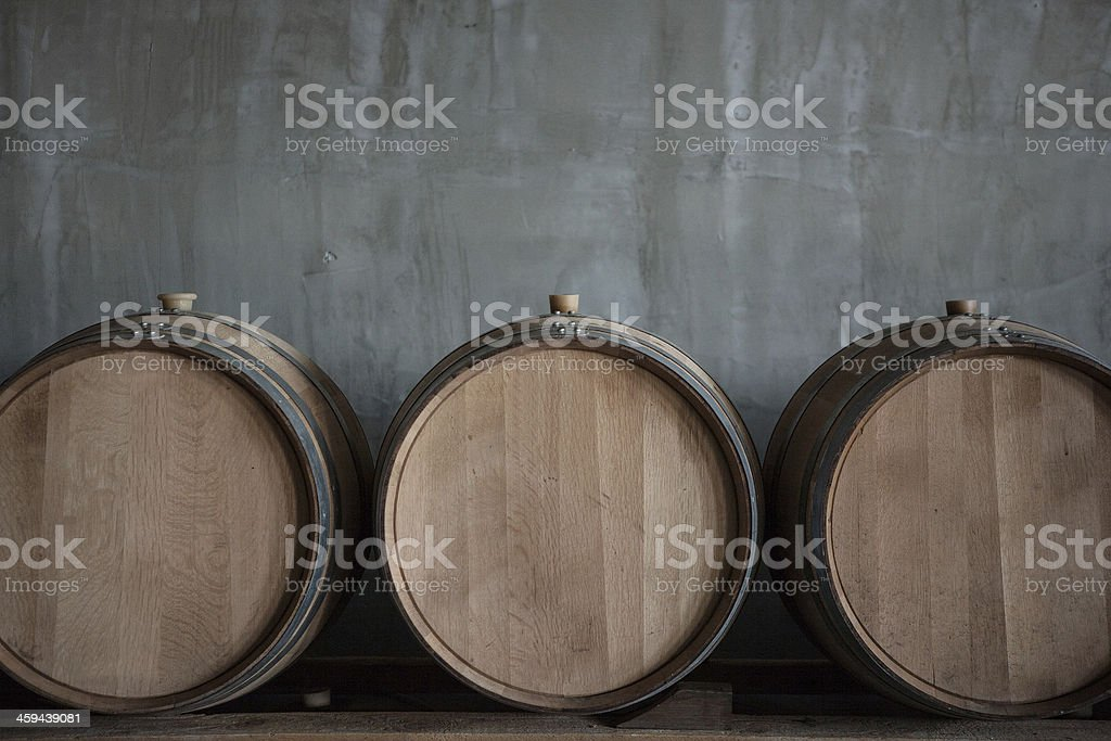 Wine barrels stacked in cellar of the winery stock photo