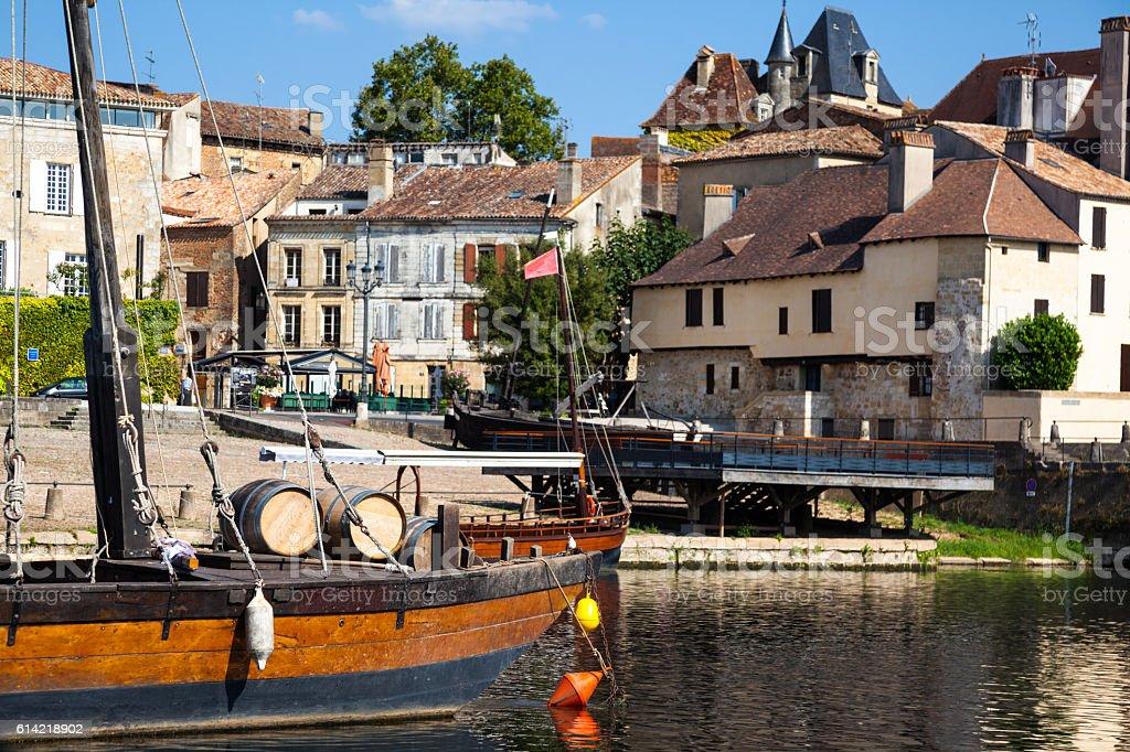 wine barrels traditional gabarre boat quayside port Bergerac Dordogne France stock photo