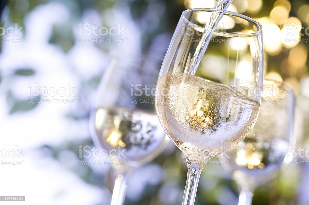Wine being poured into glass stock photo