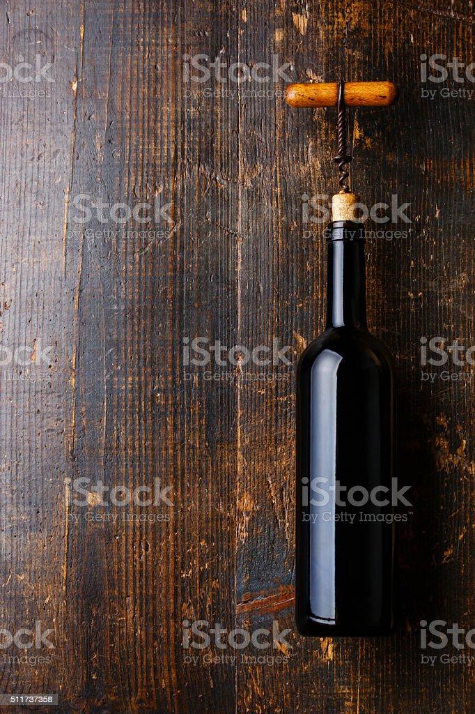 Wine bottle and corkscrew stock photo