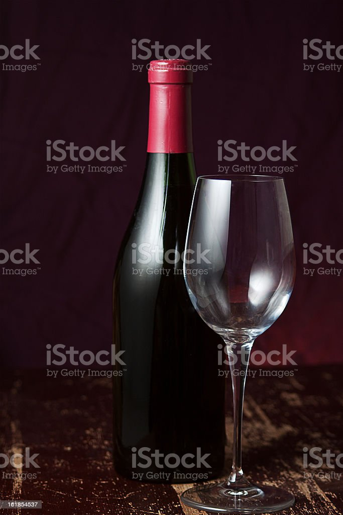 Wine Bottle and Empty Glass royalty-free stock photo