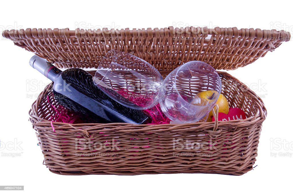 Wine bottle and glasses in a picnic box royalty-free stock photo