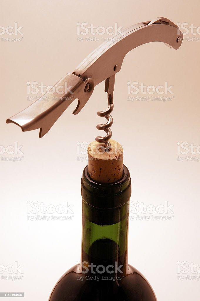 Wine Bottle and Waiter's Corkscrewl royalty-free stock photo