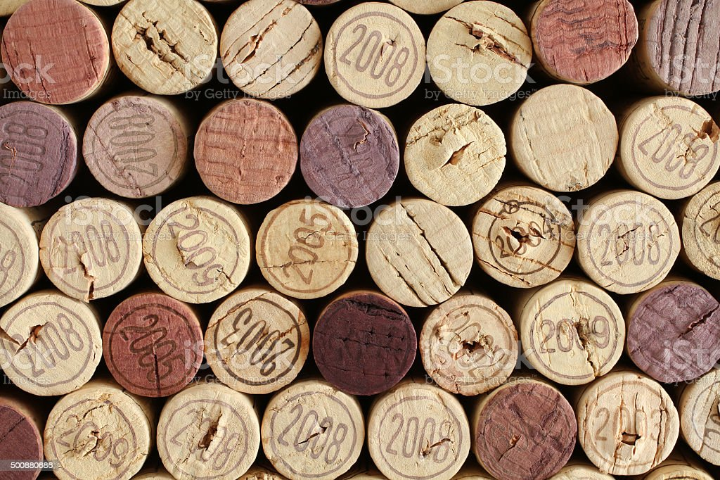 Wine bottle cork tops arranged tightly each other stock photo