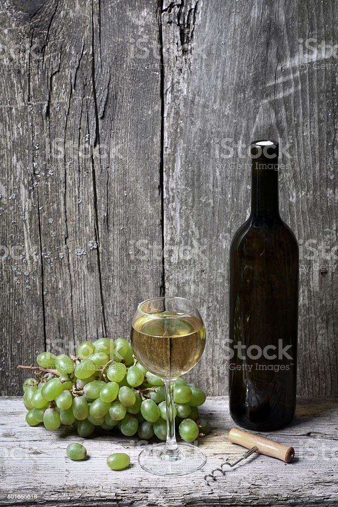 wine bottle, grapes and a glass of wine stock photo