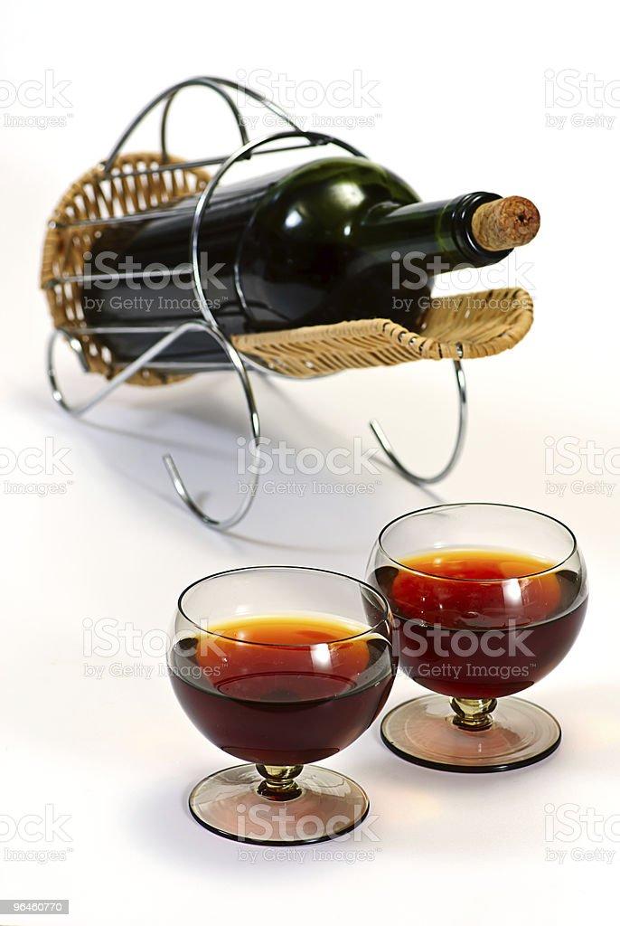 wine bottle in basket stock photo