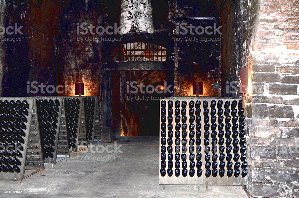 Wine bottle in the old cellar of a winery stock photo