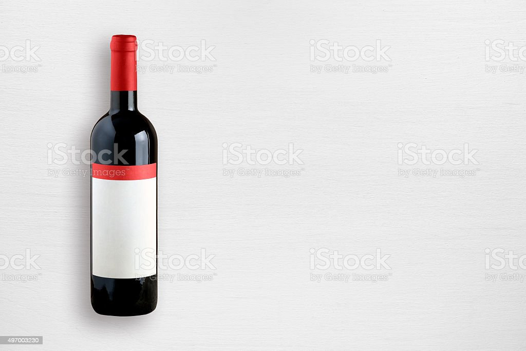 Wine bottle on white table stock photo