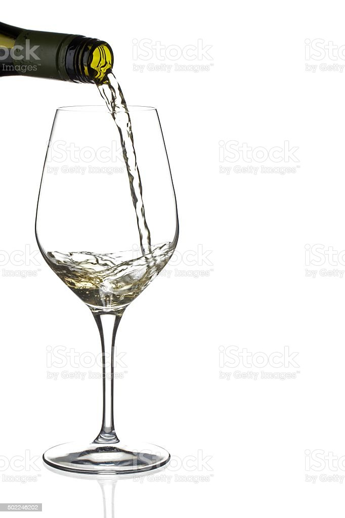 wine bottle pouring wine in wineglass stock photo