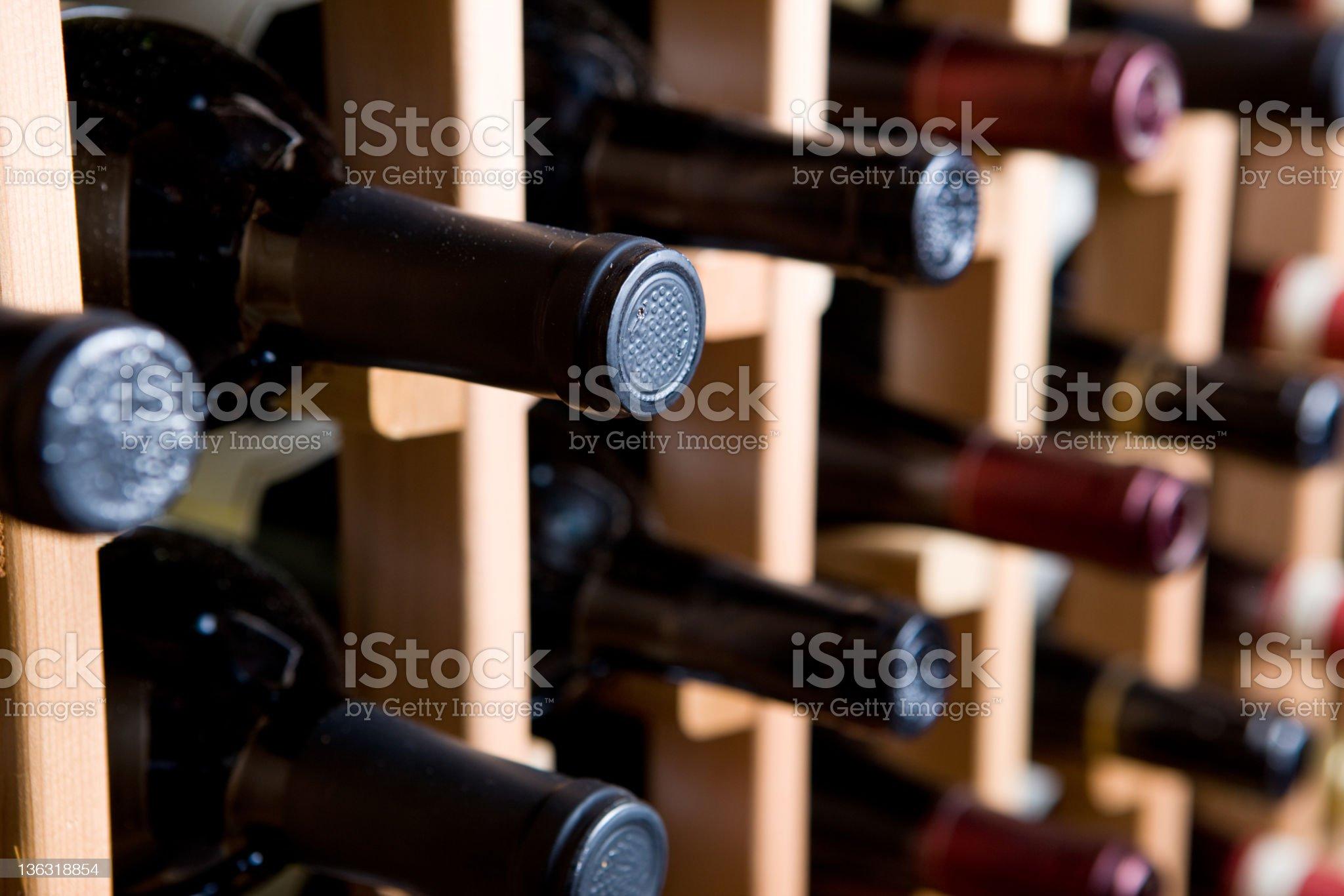 Wine bottle rack holding several bottles royalty-free stock photo