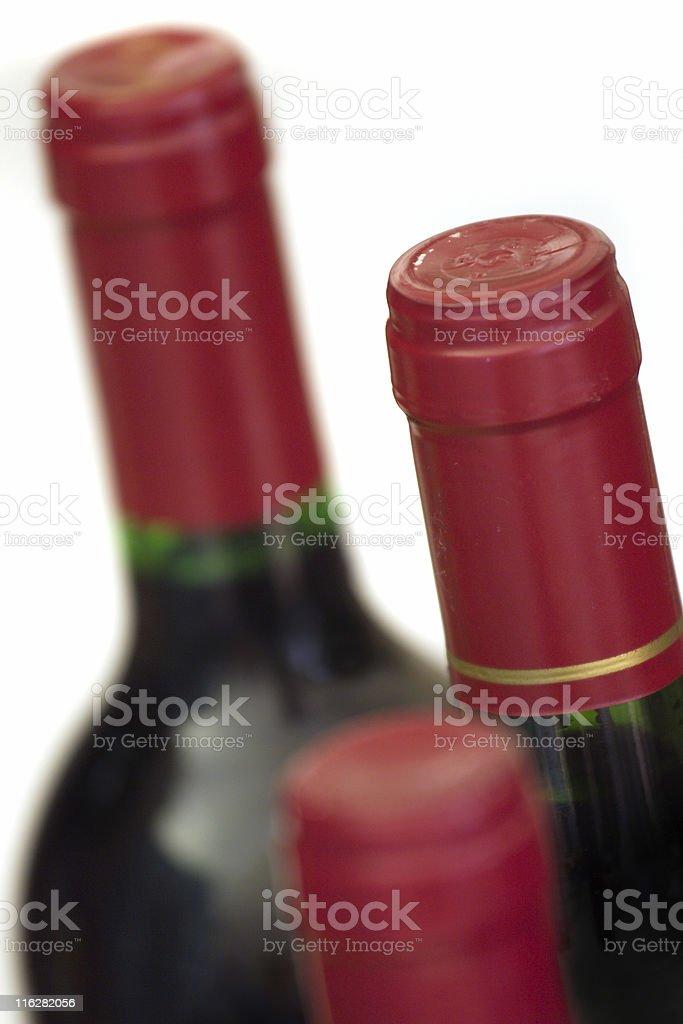 Wine bottle trio. royalty-free stock photo