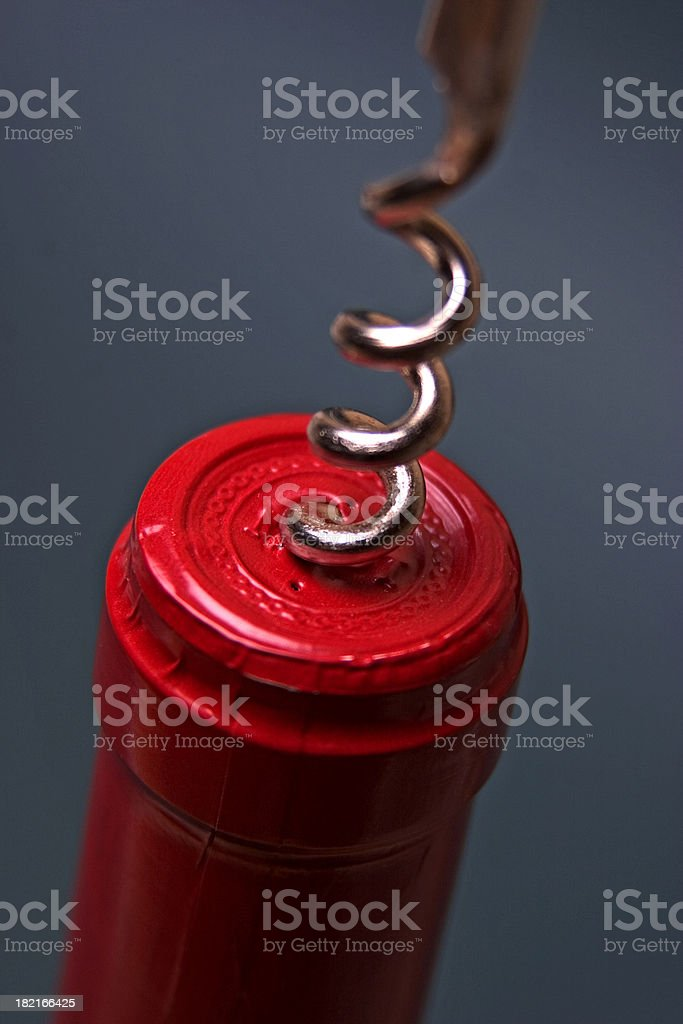 Wine Bottle with Corkscrew  Closeup royalty-free stock photo