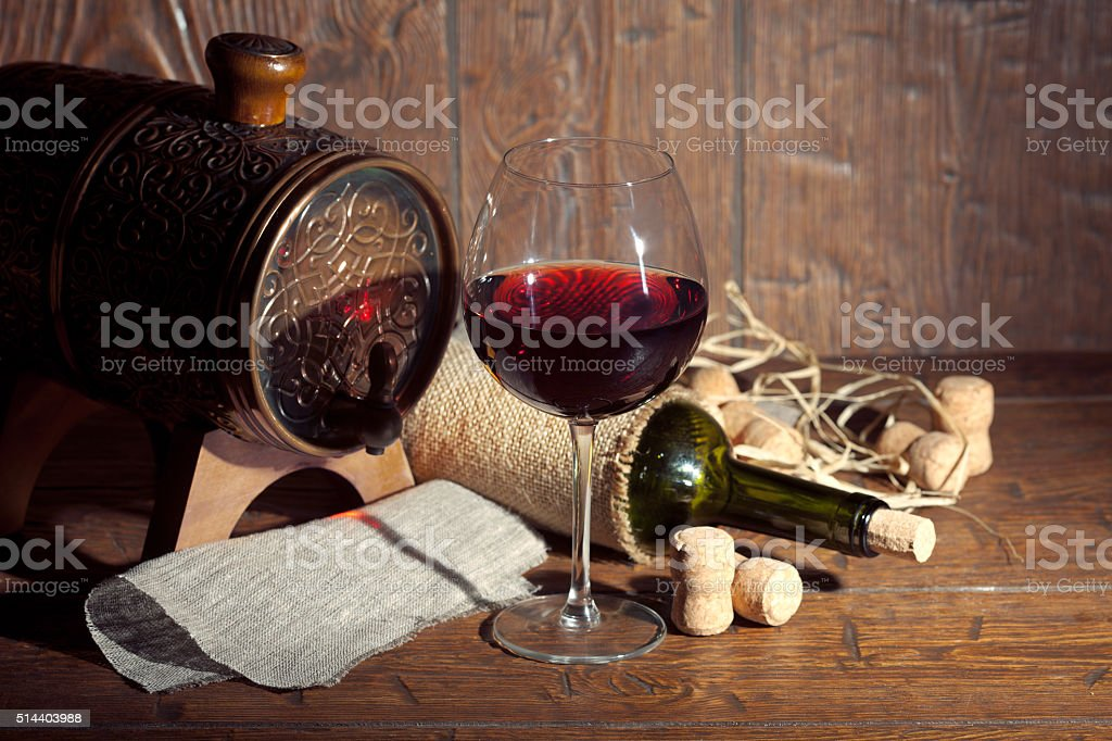 Wine bottle with glass on wooden background stock photo
