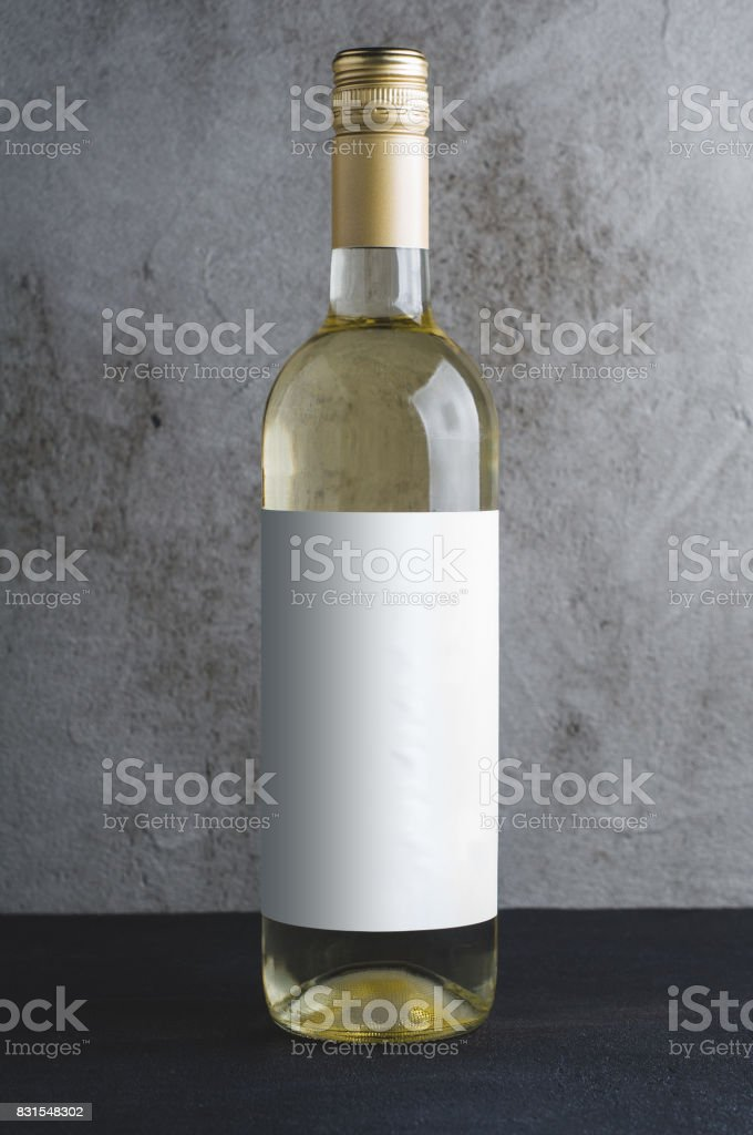 Wine bottle with the white label on a concrete background. Mock up...