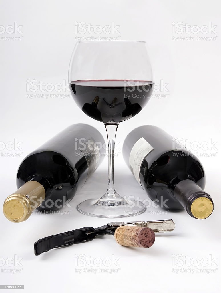 Wine bottles and a glass of red vino royalty-free stock photo