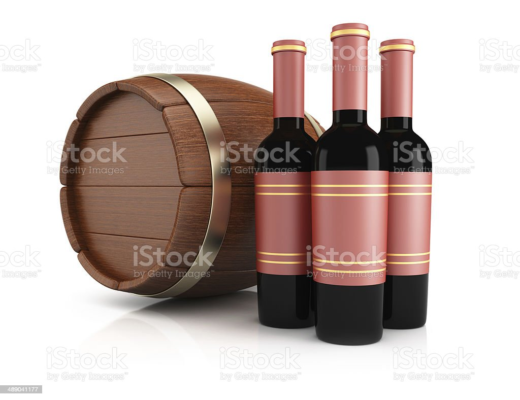 Wine bottles and barrel royalty-free stock photo
